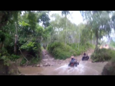 ATV All terrain vehicle ride - Passing a river on an ATV